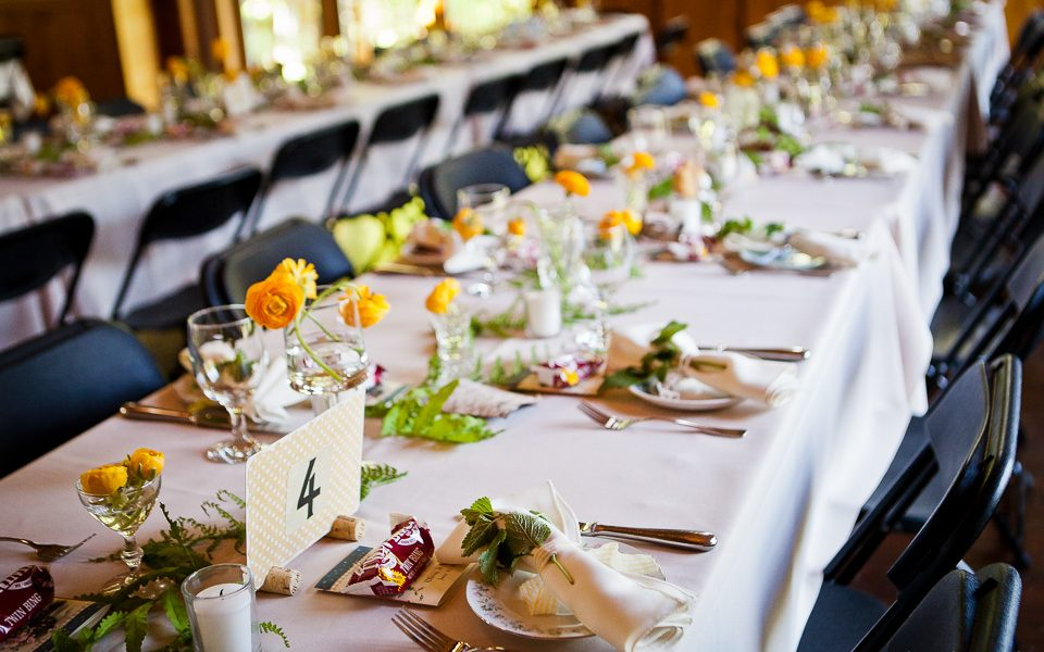 couple of long tables formally set with spring vibrance