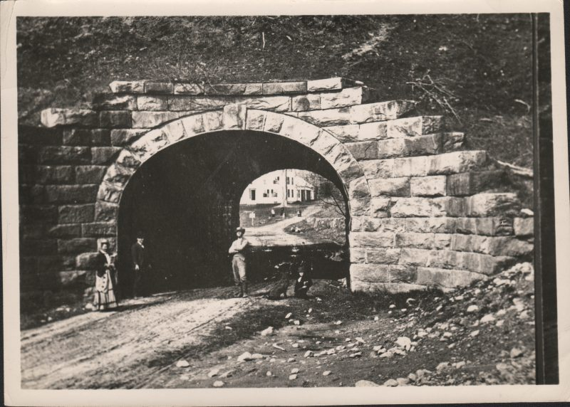 Old black and white photo of people standing before the tunnel on Chesterfield Road