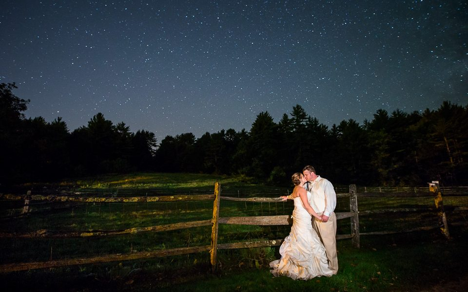 bride and groom kissing under the stars