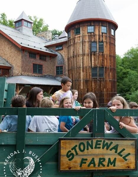 Campers on a hayride in front of the silo