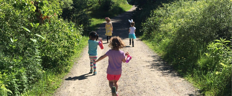 Kids running down path at the farm