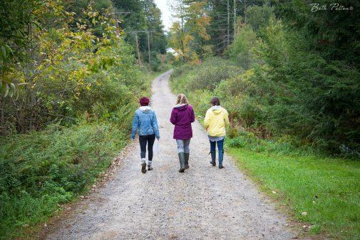 Caroline Campano and Amy Bright walk with Youth Education Director Tara Pratt