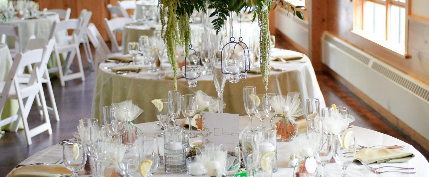 a bridal table formally set with pastel colors of sage and lemon