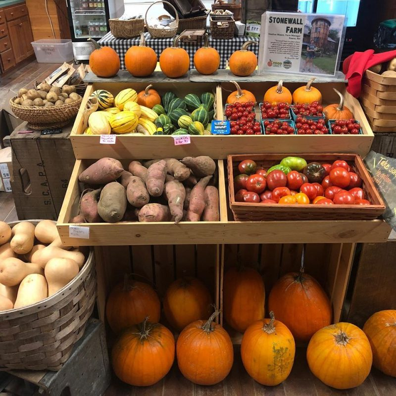 Fresh veggies in wooden bins ready to purchase