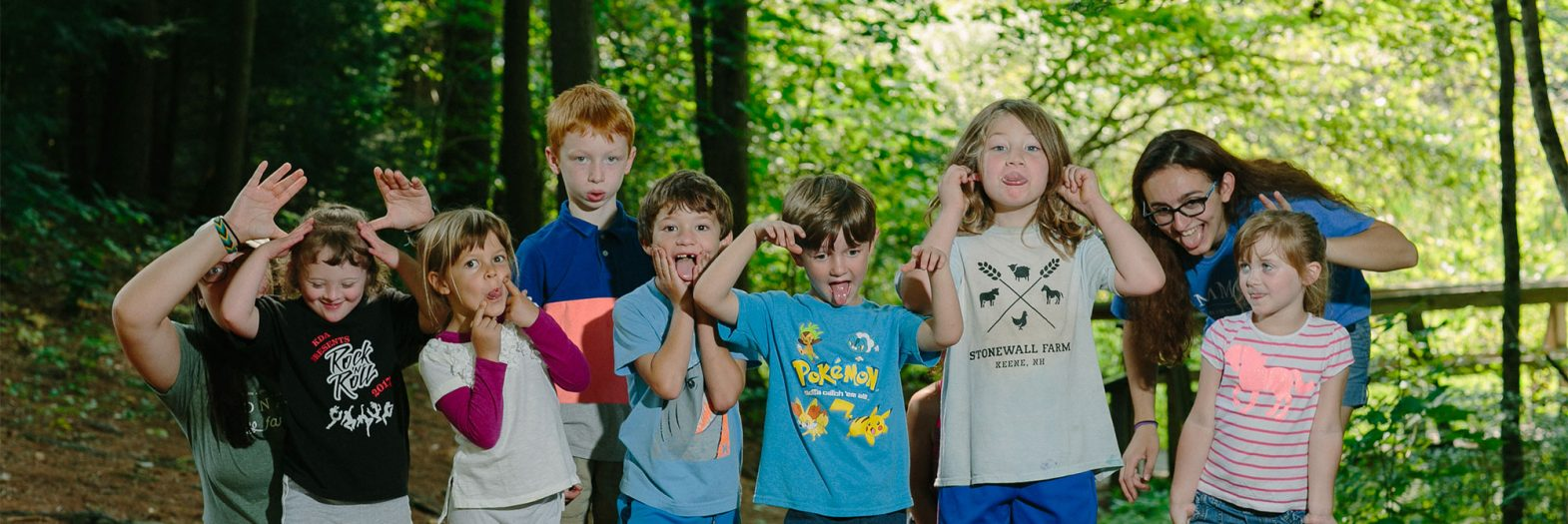 Camp group posing for a picture making funny faces