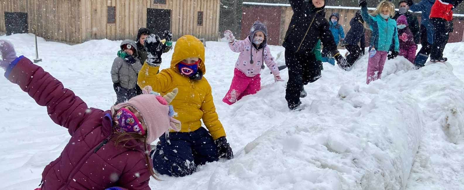 kids having fun in the snow at stonewall farm.