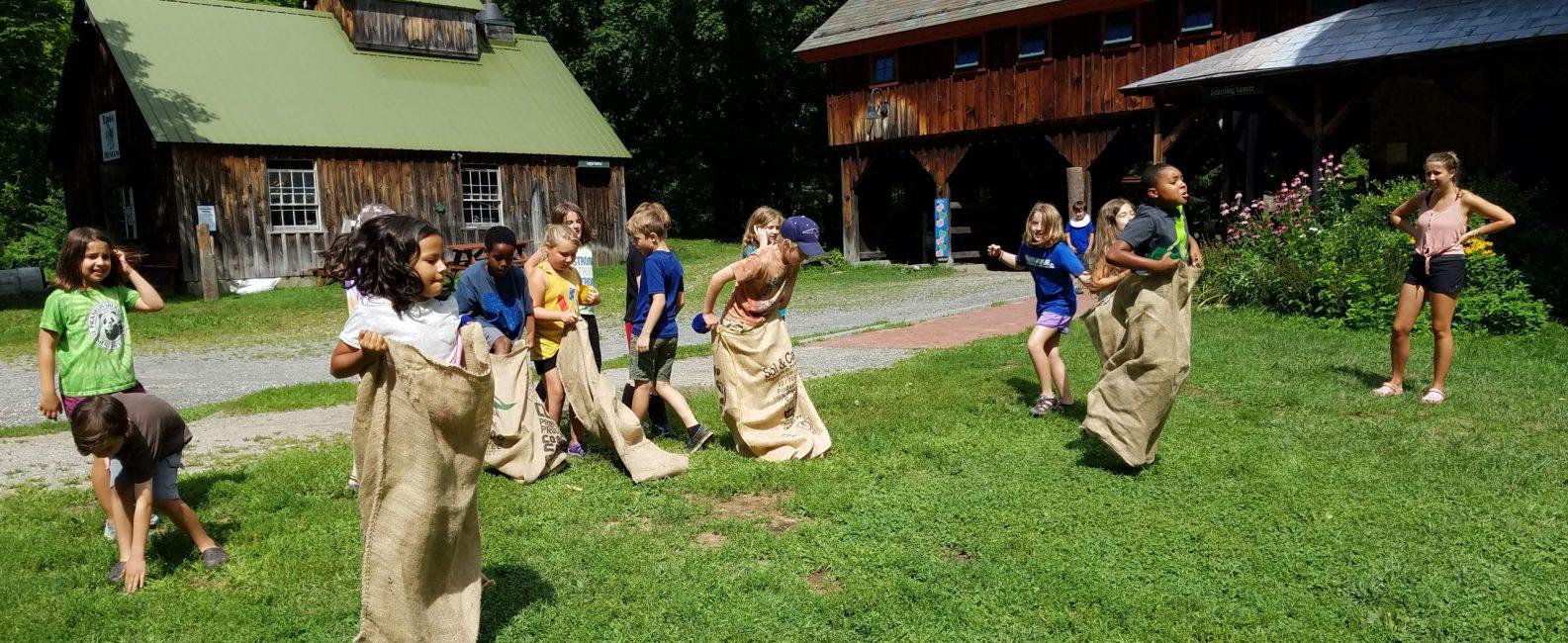 Children doing sack races.