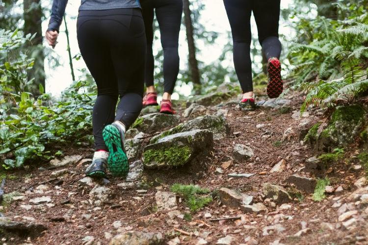 people running through woods
